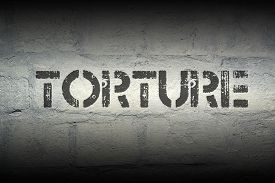 pic of torture  - torture stencil print on the grunge white brick wall - JPG