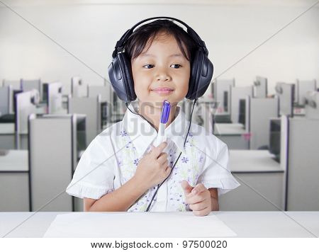 Girl With Headphones In Multimedia Room