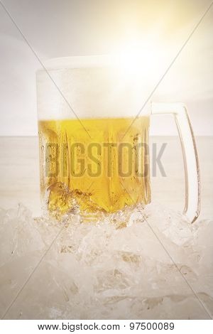 Glass Of Beer With Foam And Ice Cube