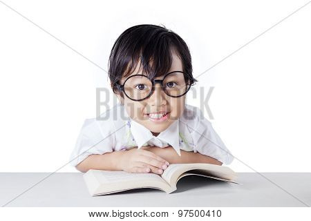 Little Girl With Cute Face And Book