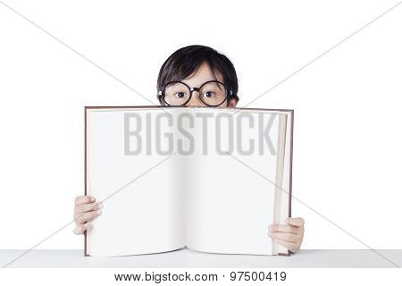 Little Girl With Glasses And Empty Book