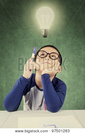 Pensive Clever Boy Under Light Bulb