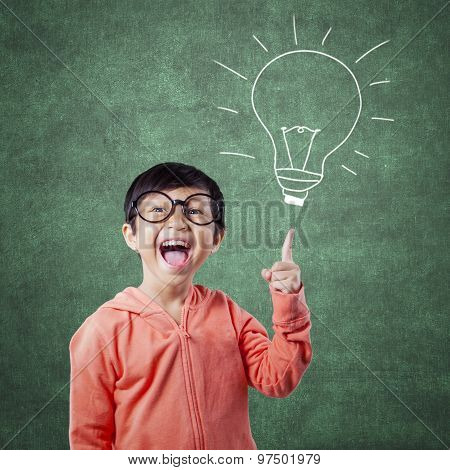 Smart Student Pointing At Lamp Picture