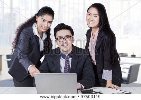 Three Corporate Workers With Laptop In Office