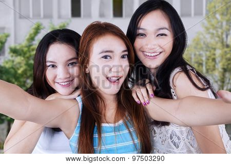 Three Students Taking Photo At School