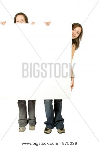 Twin Sisters Holding A White Banner