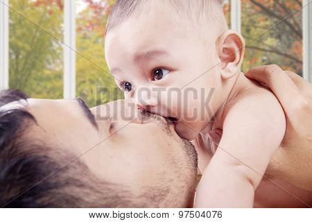 Young Dad Kiss Baby's Mouth