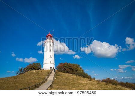 Lighthouse Dornbusch on the island of Hiddensee in blue sky