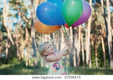 Girl With An Armful Of Balloons