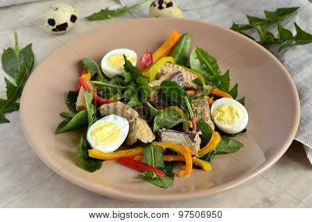 Fish salad with quail eggs, sweet peppers, herbs