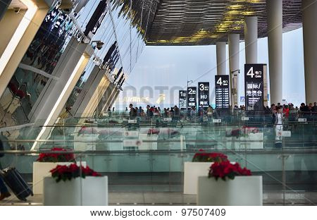 SHENZHEN, CHINA - FEBRUARY 16, 2015: airport entrance gates. Shenzhen Bao'an International Airport is located near Huangtian and Fuyong villages in Bao'an District, Shenzhen, Guangdong