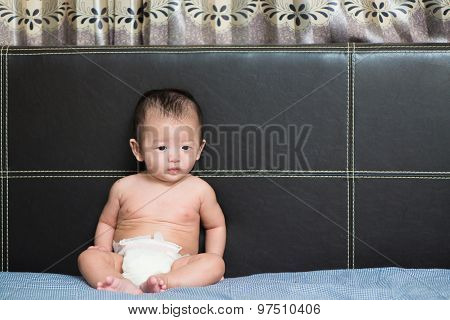 Cute Asian Baby Sitting On Bed, Shallow Dof, Focus On Eyes.