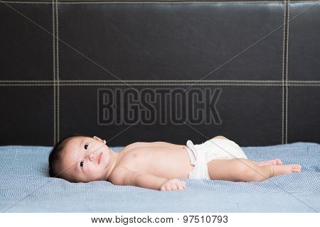 Cute Asian Baby Lying On Bed, Shallow Dof, Focus On Eyes.