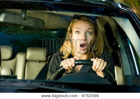 Fright Face Of Woman Driving Car