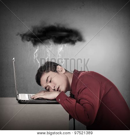 Business Man Sleeping On The Front Of Laptop