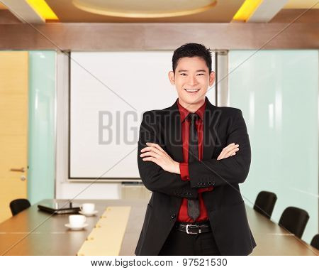 Asian Business Man With Folded Hand Smiling