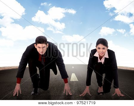 Two Asian Business Man And Woman Starting Run