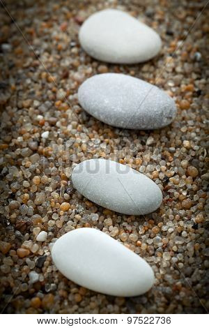 Stones Lie On Coarse Sand