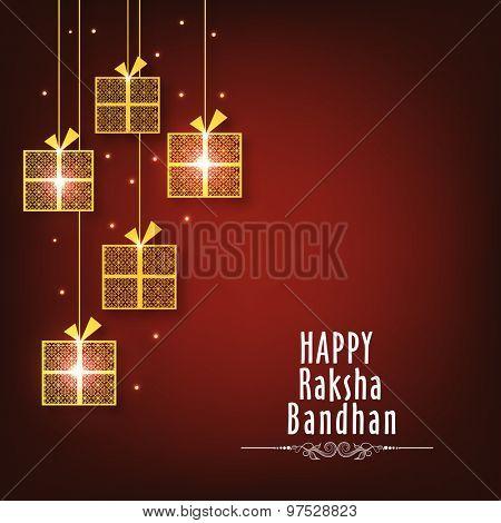 Golden hanging gifts on shiny background, Elegant greeting card design for Indian festival of brother and sister love, Happy Raksha Bandhan celebration.