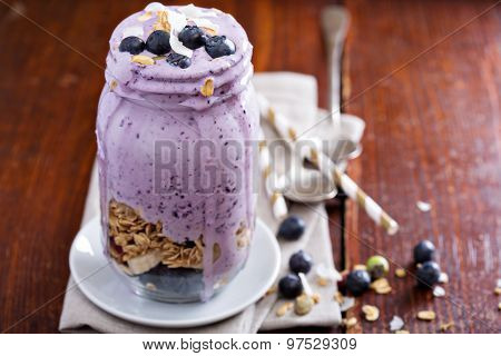 Blueberry smoothie with fruits and granola