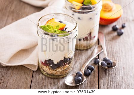 Layered breakfast parfait with granola and fruits