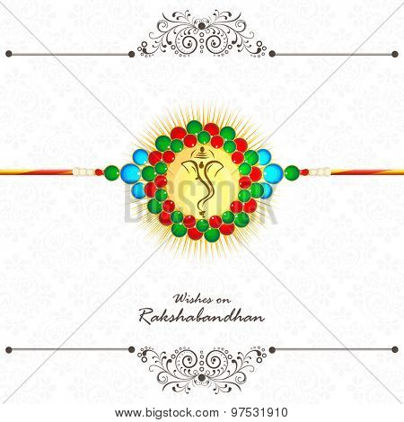Beautiful creative rakhi with face of Lord Ganesha for Indian festival of brother and sister love, Happy Raksha Bandhan celebration.