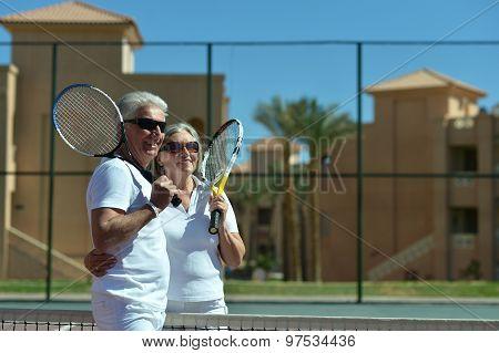 Senior couple on tennis court