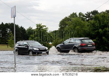 GDANSK, POLAND - July 28: Cars trying to drive against flood on the street on July 28, 2015 in Gdansk, Poland. Storms and heavy rains hit many parts of Poland and Europe