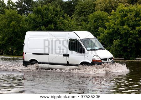 GDANSK, POLAND - July 28: Car trying to drive against flood on the street on July 28, 2015 in Gdansk, Poland. Storms and heavy rains hit many parts of Poland and Europe