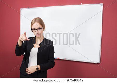 girl in glasses pointing her finger