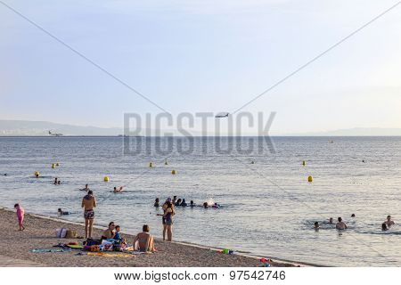 People Relax At The Beach In Front Of Marseille Provence Airport