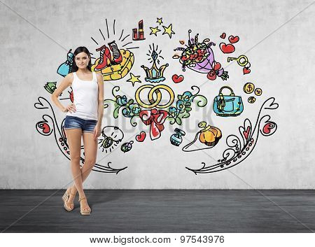 Full Length Portrait Of A Brunette Woman Who Is In A White Tank Top And Blue Denim Shorts. She Is Dr