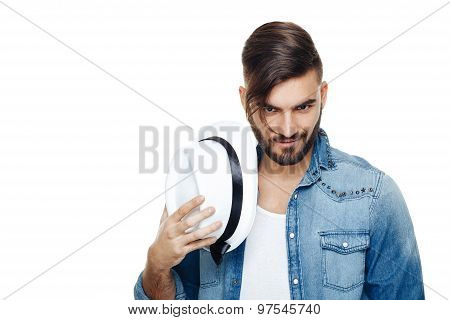 Bearded Man With A Hat Posing In The Studio