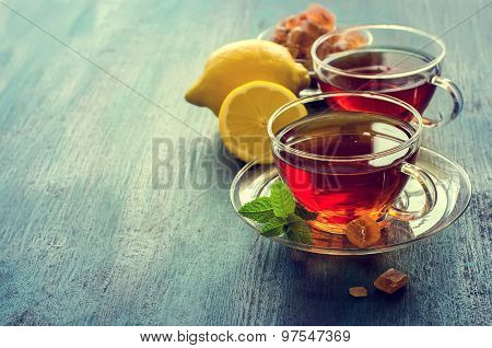 Cup Of Tea With Mint Leaf And Chrystal Sugar On Dark Rustic Background