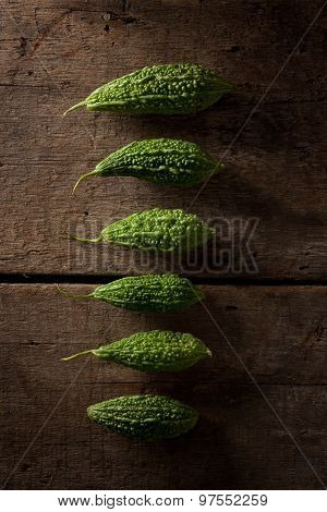 fresh bitter melon on a wood background