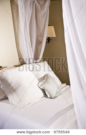 Pillows On A White Canopy Bed