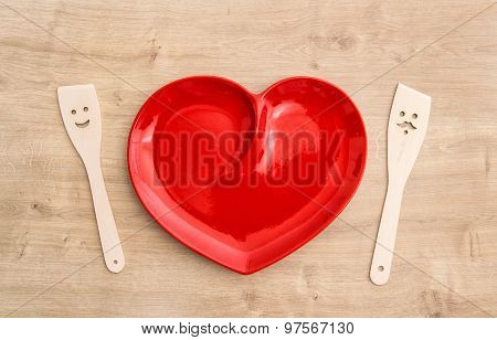 Wooden Kitchen Utensils And Red Tablecloth. Funny Tools