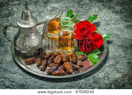Tea, Dates Fruits And Red Rose Flowers. Oriental Hospitality Vintage