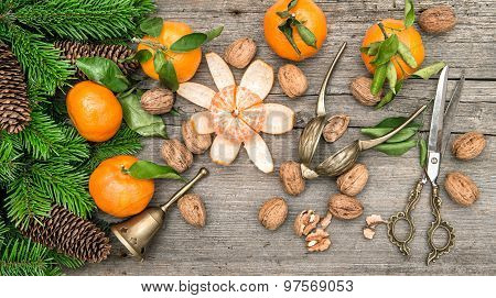 Christmas Decoration With Tangerine Fruits And Walnuts