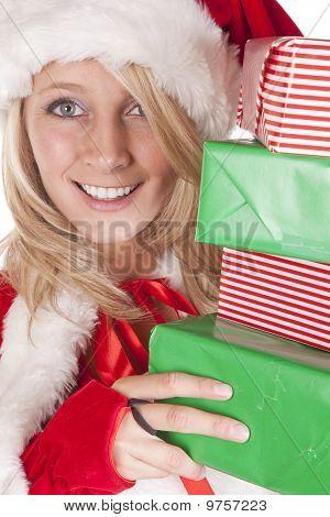 Santas Helper Peeking Around Presents