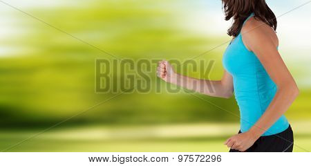 CLose-up of woman runner. Detail on body and arms with blur motion background. Concept of body training and healthy lifestyle.