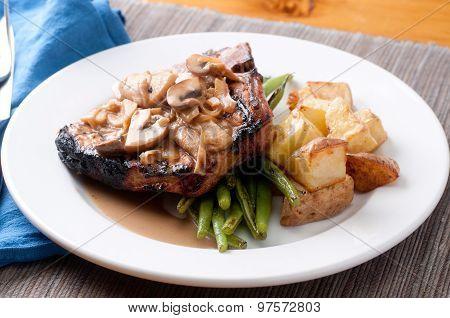 Grilled Pork Chop With Apple Mushroom Sauce