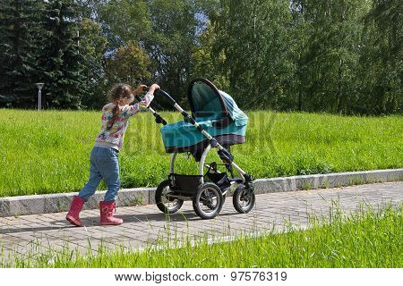 little girl walking with stroller alone