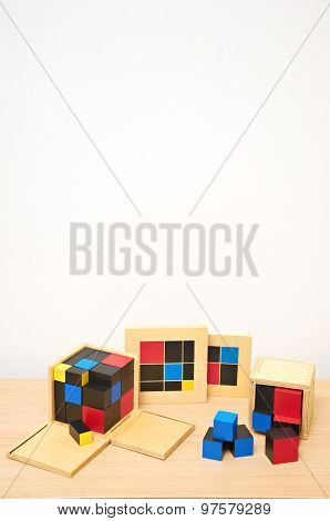 Kids Montessori Material on Wooden Surface
