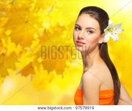 Young girl with flower on autumnal background