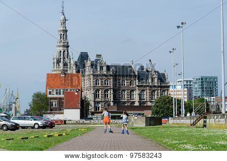 Antwerp, Belgium - May 11, 2015: Children Roller Skating Against Pilotage Building In Antwerp