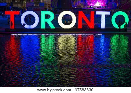 TORONTO,CANADA-JULY 9,2015: The new Toronto sign in Nathan Phillips Square celebrating the PanAm games, a stage have been mounted to held a constant party called Panamania