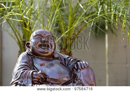 Happy Buddha In Garden Patio
