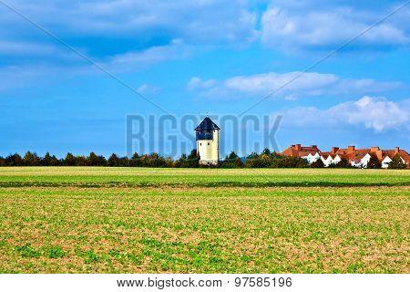 Settlement Beside An Old Watertower