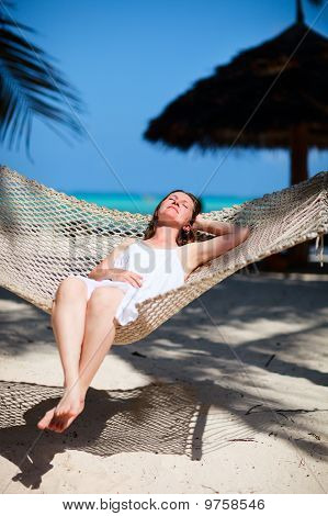 Woman Relaxing In Hammock